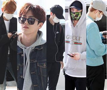 EXO现身机场开启北美二巡 伯贤灿烈口罩遮面显疲惫