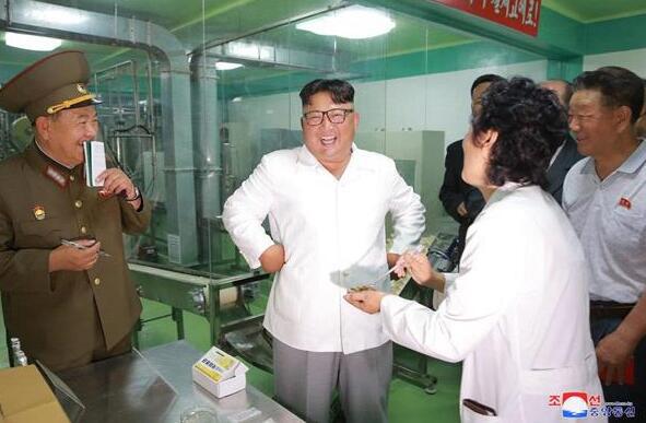 金正恩視察朝軍方食品加工廠納豆生產線稱納豆好吃且健康